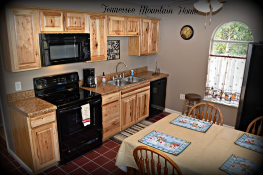 Kitchen area featuring dishwasher stove refrigerator and mircrowave all kitchen utensils and cookware